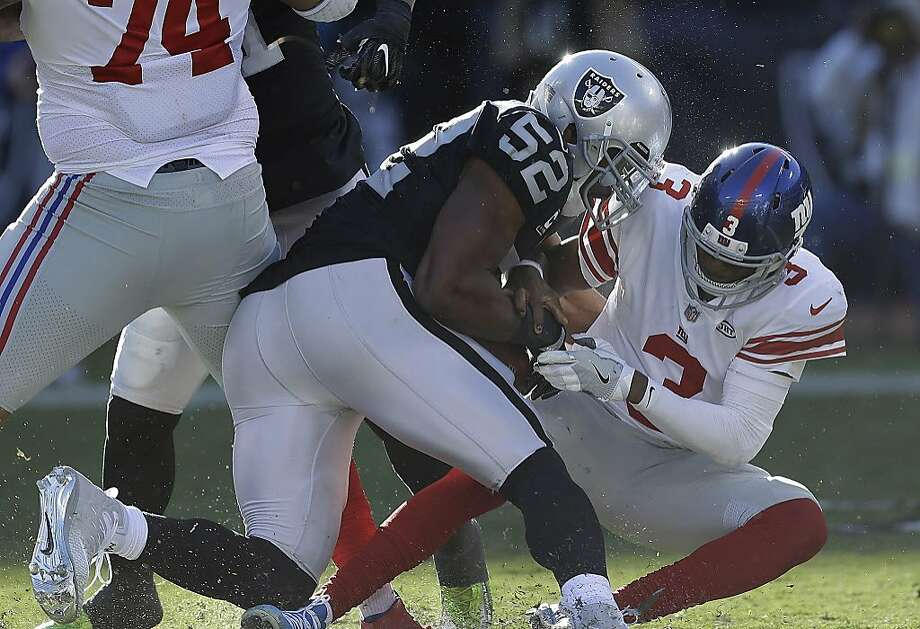 Oakland Raiders defensive end Khalil Mack (52) sacks and forces a fumble from New York Giants quarterback Geno Smith during the first half of an NFL football game in Oakland, Calif., Sunday, Dec. 3, 2017. Mack recovered the fumble. (AP Photo/Ben Margot) Photo: Ben Margot, Associated Press