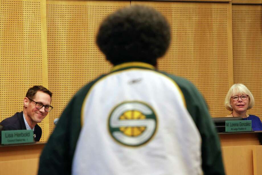 "Councilmembers Rob Johnson, left, and Sally Bagshaw, right, listen as Seattle SuperSonics fan Kris ""Sonics Guy"" Brannon speaks during a public comment section of a City Council meeting in which the council voted 7-1 in favor of an agreement with Oak View Group to renovate KeyArena, Monday, Dec. 4, 2017. Photo: GENNA MARTIN, SEATTLEPI / SEATTLEPI"