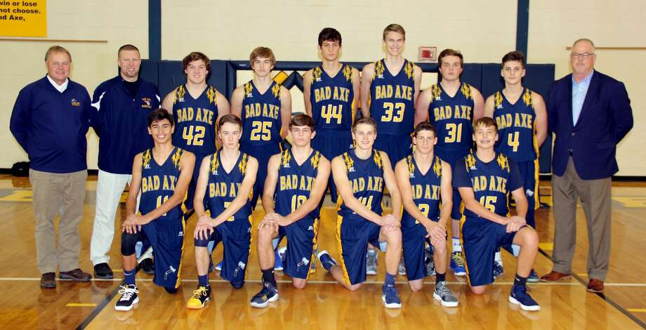 Members of the Bad Axe boys varsity basketball team are (front row from left) Jensen Emerick, James Kervin, Jack Clancy, Joe Messing, Spencer Britt and Colby Meeks (back row) assistant coach Pat Flannery, assistant coach Jason Jurgess, Wyatt Humphrey-Phillips, Cody Talaski, Austin Mosack, Robby Sutton, Austin Affer, Jared Sobczak and head coach Mark Krug.  Photo: Paul P. Adams/Huron Daily Tribune