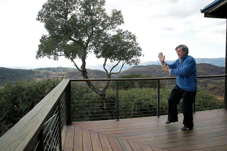Screenwriter Robert Mark Kamen practices martial arts daily on his patio at home in his beloved organic vineyard in Sonoma, which was surrounded by fire in October but didn't burn. Photo: Liz Hafalia, The Chronicle