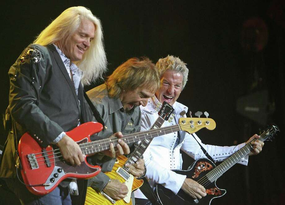 REO Speedwagon band members, left to right, Bruce Hall, Dave Amato and Kevin Cronin perform Sunday, June 7, 2009 at the Cynthia Woods Mitchell Pavilion in The Woodlands, Texas. Photo: Eric S. Swist /Houston Chronicle / Staff photo by Eric S. Swist