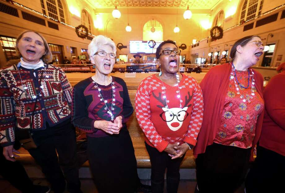 Left to right, Sheila Bonenberger, co-founder, Betty Brainerd, Marie Mason, Ann Petracek and the rest of the Salt and Pepper Gospel Singers perform Christmas Carols and hymns for travelers at Union Station in New Haven on December 4, 2017. Photo: Arnold Gold / Hearst Connecticut Media / New Haven Register