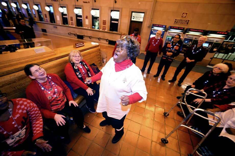 Mae Gibson-Brown (center), co-founder of the Salt and Pepper Gospel Singers, perform Christmas Carols and hymns with the group for travelers at Union Station in New Haven on December 4, 2017. Photo: Arnold Gold / Hearst Connecticut Media / New Haven Register