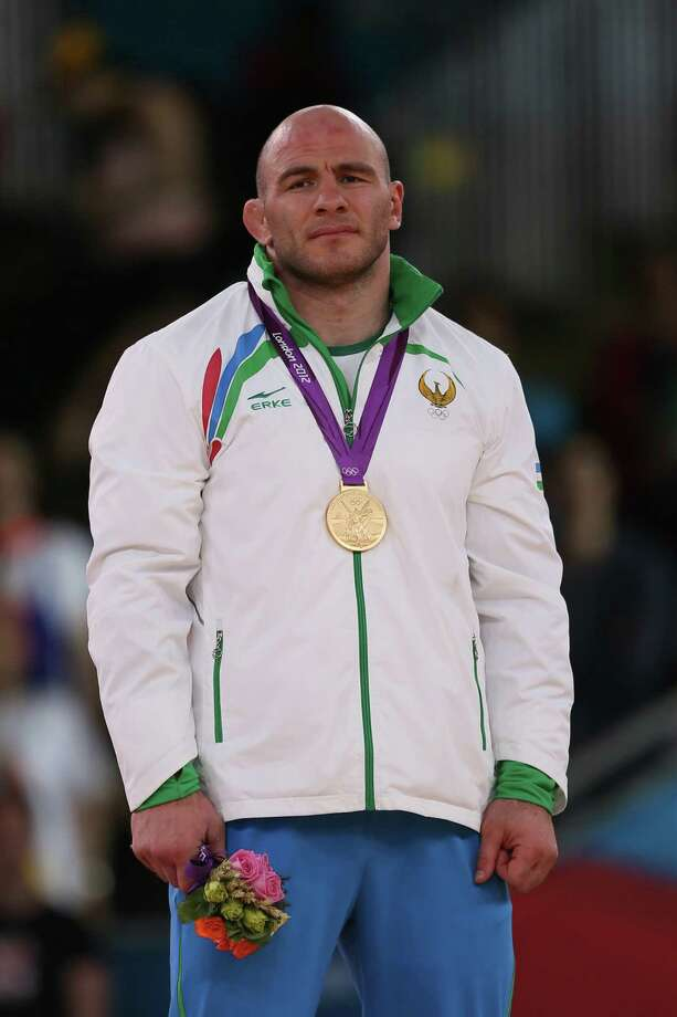 Gold medallist Uzbekistan's  Artur Taymazov poses on the podium of the Men's 120kg on August 11, 2012 during the wrestling event of the London 2012 Olympic Games.  AFP PHOTO / MARWAN NAAMANI        (MARWAN NAAMANI/AFP/GettyImages) Photo: MARWAN NAAMANI / 2012 AFP