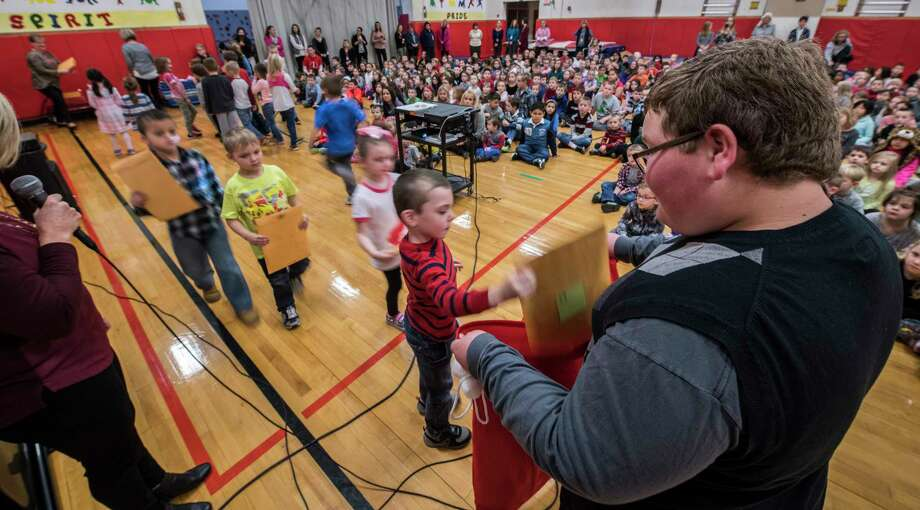 Luke Hoag, fifth-grader at Hoosick Falls Central School collects letters from students at the Tamarac Elementary School on Monday Dec 4, 2017, in Brunswick, NY.  Hoag was at the school to collect letter to Santa to be delivered to Macy's as a fund raiser for Make-A-Wish which he personally was granted a wish as a three year old.  (Skip Dickstein/ Times Union) Photo: SKIP DICKSTEIN / 20042265A