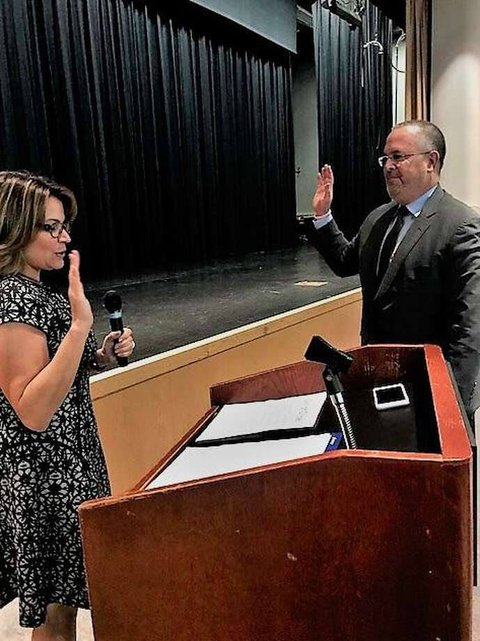 Seymour First Selectman Kurt Miller, right, receives the oath of office from state Rep. Nicole Klarides-Ditria Monday. Photo: Jean Falbo-Sosnovich / Hearst Connecticut Media