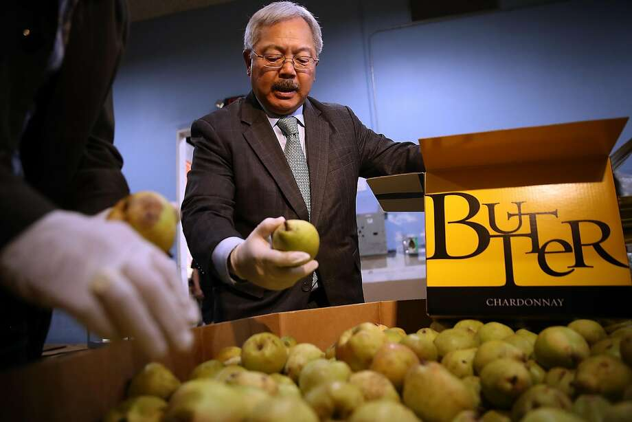 San Francisco Mayor Ed Lee sorts pears at the San Francisco-Marin Food Bank last month. He wants three new Navigation Centers open soon. Photo: Justin Sullivan, Getty Images