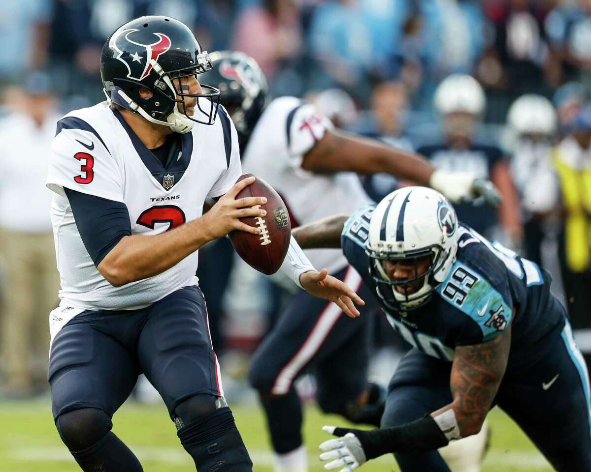 Texans QB Tom Savage (3), pressured here by Titans defensive end Jurrell Casey, threw for a career-high 365 yards in Sunday's 24-13 loss at Tennessee but was sacked four times and knocked down nine times.