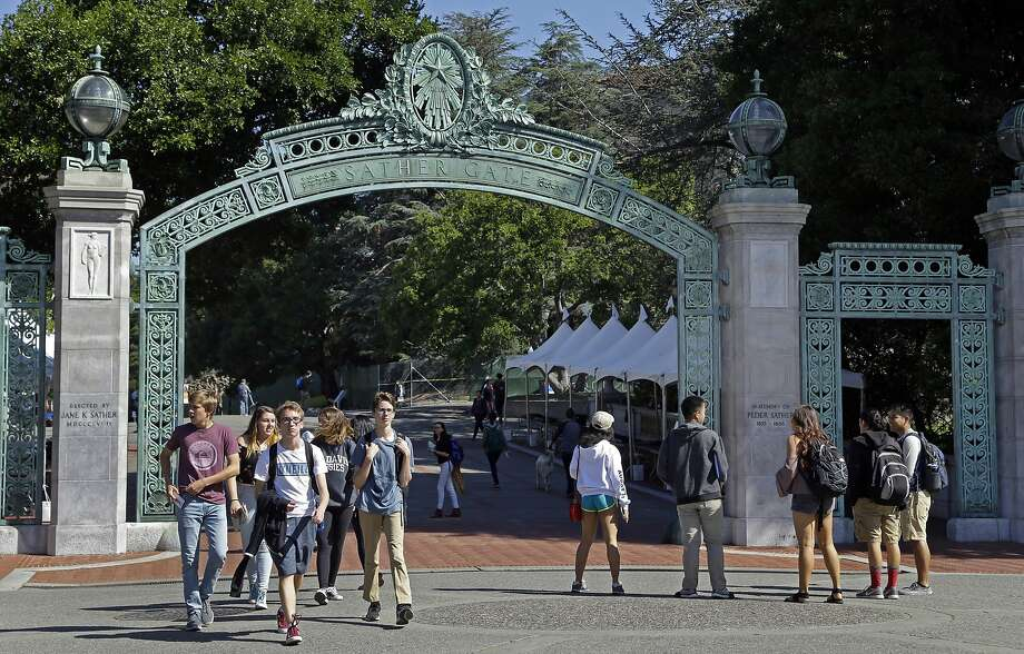 FILE - In this April 21, 2017, file photo, students walk past Sather Gate on the University of California, Berkeley campus in Berkeley, Calif.  With college classes starting soon, ideally you've made all your payments and are ready to settle in. But if you're still looking for financial aid to help cover your tuition, you'll have to move fast.  (AP Photo/Ben Margot, File) Photo: Ben Margot, Associated Press