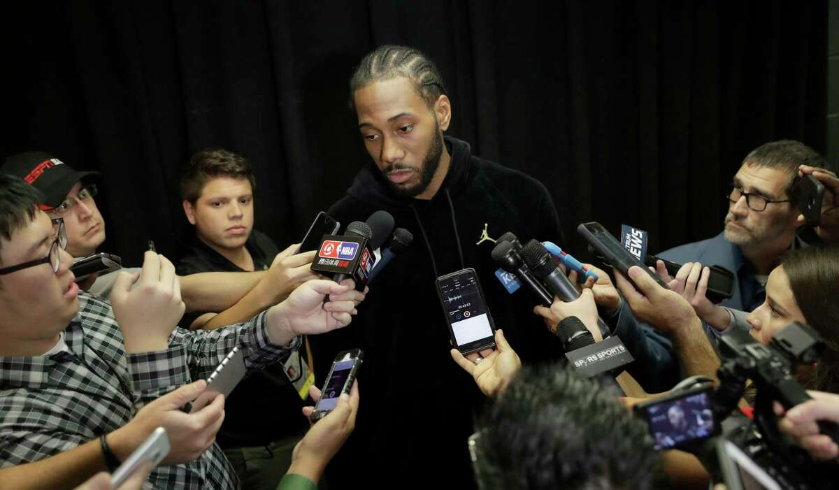 San Antonio Spurs forward Kawhi Leonard, who has not played this season due to an injury, talks with the media before an NBA basketball game against the Detroit Pistons, Monday, Dec. 4, 2017, in San Antonio. Leonard is expected to return to play soon. (AP Photo/Eric Gay)