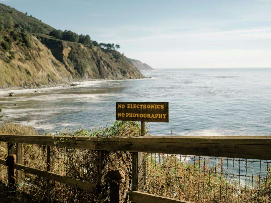 A sign prohibiting photography and electronics upon entering the clothing-optional hot baths at Esalen in Big Sur, Calif., Nov. 11, 2017. Now reopened after a difficult year of landslides and flooding, the nonprofit that helped bring yoga, organic food and meditation into the American mainstream has a new focus on healing the wounded soul of Silicon Valley. (Jason Henry/The New York Times) Photo: JASON HENRY, STR / NYTNS