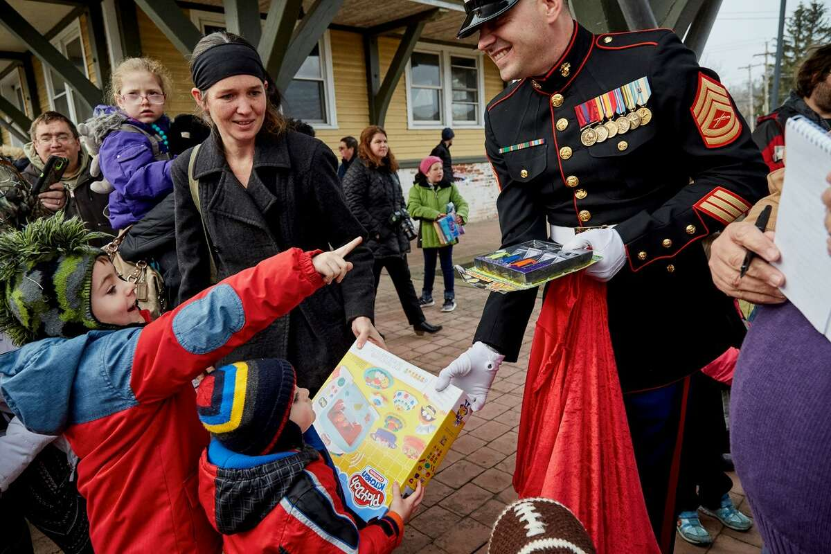 Gunnery Sgt. Christopher M. Croteau greets people at a Toys for Tots train stop. (Provided)