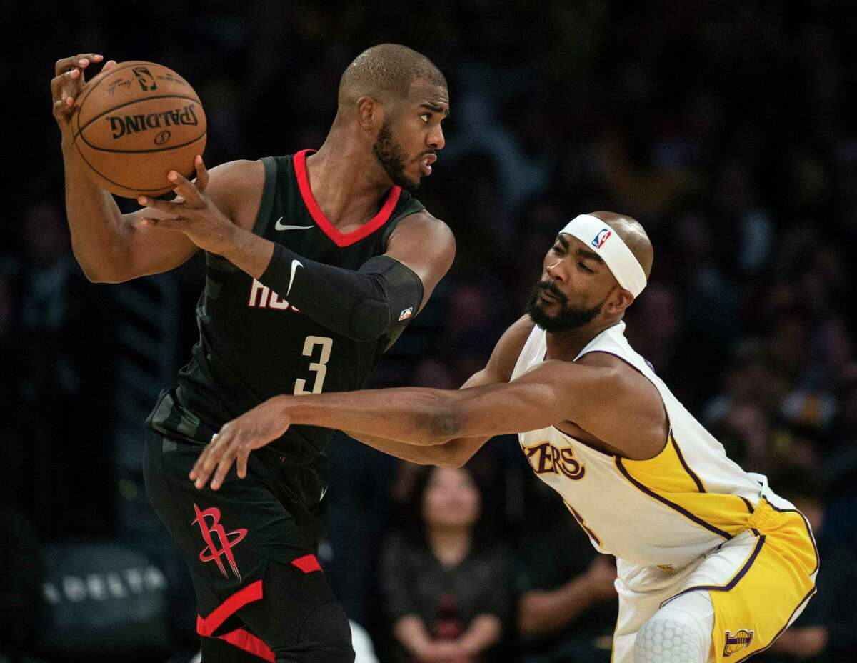 Los Angeles Lakers forward Corey Brewer, right, defends Houston Rockets guard Chris Paul (3) during the second half of an NBA basketball game Sunday, Dec. 3, 2017, in Los Angeles. (AP Photo/Kyusung Gong)