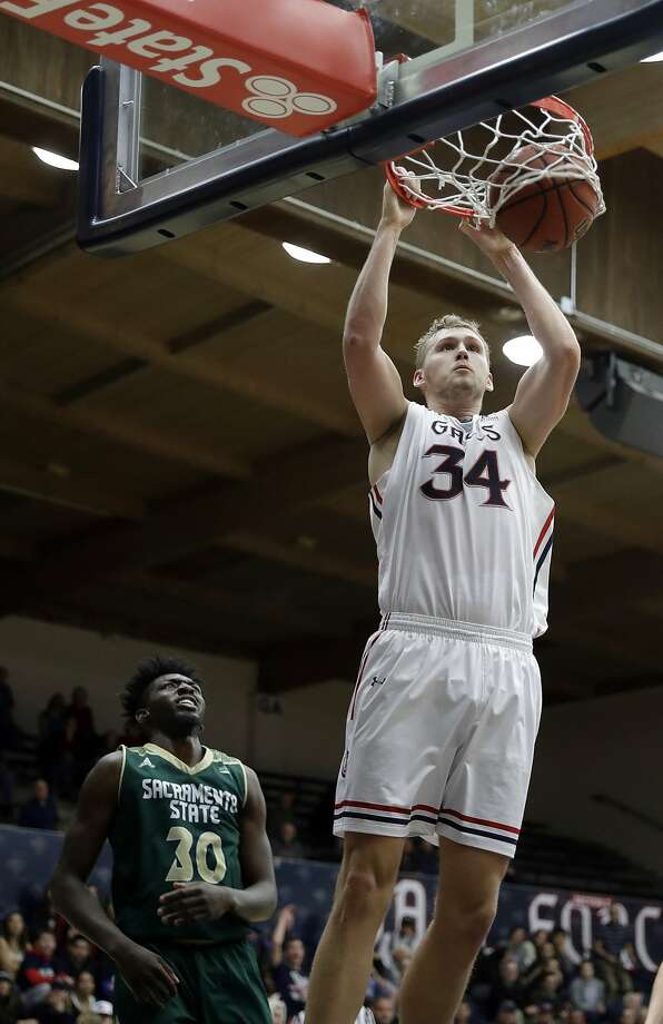 Saint Mary's center Jock Landale (34) dunks past Sacramento State forward Joshua Patton (30) during the first half of an NCAA college basketball game on Monday, Dec. 4, 2017, in Moraga, Calif. (AP Photo/Marcio Jose Sanchez) Photo: Marcio Jose Sanchez, Associated Press