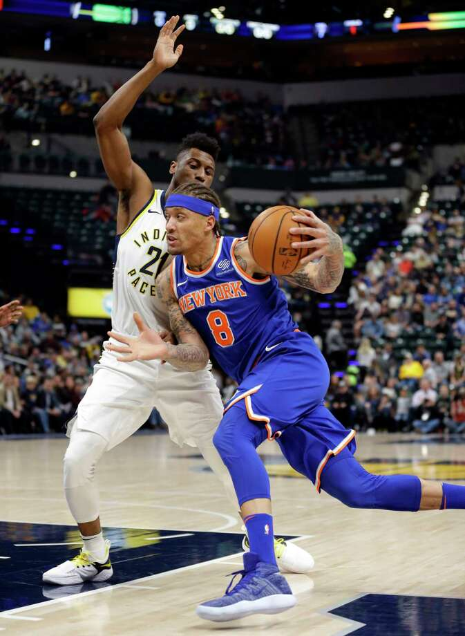 New York Knicks forward Michael Beasley (8) drives on Indiana Pacers forward Thaddeus Young (21) during the first half of an NBA basketball game in Indianapolis, Monday, Dec. 4, 2017. (AP Photo/Michael Conroy) ORG XMIT: NAF105 Photo: Michael Conroy / Copyright 2017 The Associated Press. All rights reserved.