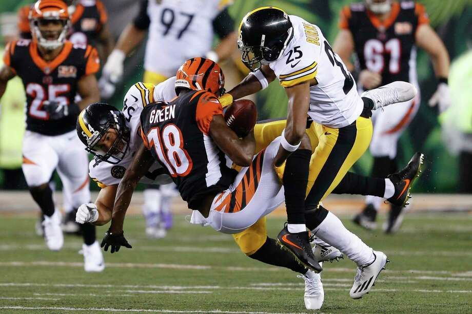 Cincinnati Bengals wide receiver A.J. Green (18) is tackled by Pittsburgh Steelers linebacker L.J. Fort (54) and cornerback Artie Burns (25) in the second half of an NFL football game, Monday, Dec. 4, 2017, in Cincinnati. (AP Photo/Gary Landers) ORG XMIT: OHJM143 Photo: Gary Landers / AP