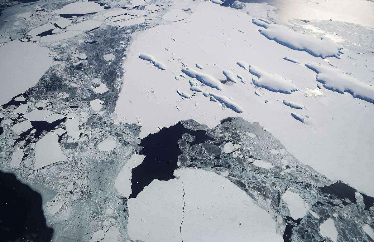 IN FLIGHT, ANTARCTICA - NOVEMBER 3: Sea ice floats around a group of islands (TOP R) as seen from NASA's Operation IceBridge research aircraft off the coast of the Antarctic Peninsula region, on November 3, 2017, above Antarctica.