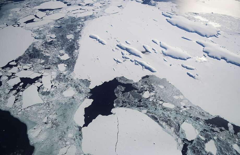 IN FLIGHT, ANTARCTICA - NOVEMBER 3: Sea ice floats around a group of islands (TOP R) as seen from NASA's Operation IceBridge research aircraft off the coast of the Antarctic Peninsula region, on November 3, 2017, above Antarctica.  Photo: Mario Tama, Getty Images