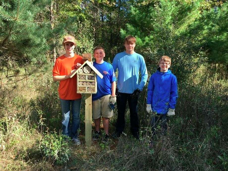 Shane Hogan, left, stands with other members ofTroop 763. Shanebuilt and installed insect hotels for the Little Forks Conservancy. (Photo provided)