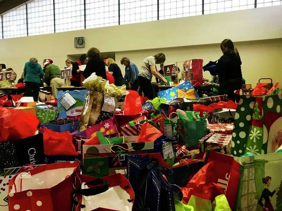 Volunteers gatherMondayat Blessed Sacrament Church to sort through thousands of donated gifts that will be delivered to Midland County residents as a part of the United Way Sharing Tree Program. (Kate Carlson/kcarlson@mdn.net)