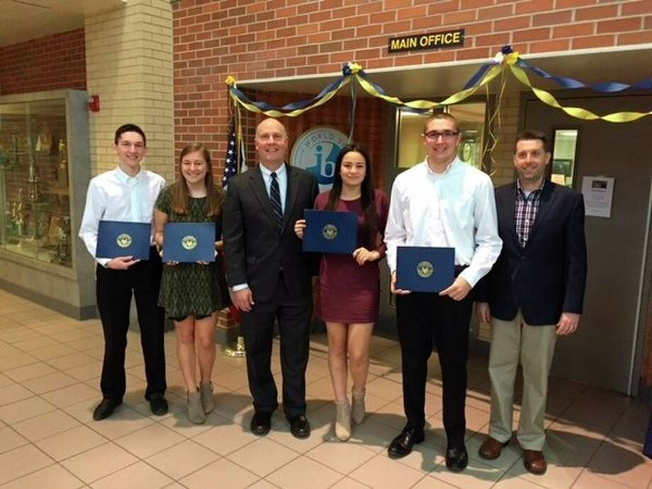Rep. John Moolenaar was at Midland High on Monday to honor four students as winners of the 2017 Congressional App Challenge Award for the Fourth Congressional District. From left, Preston Millward, Emma Jamrog, Moolenaar, Gwynne Ozkan, Gerard Bringard and teacher/adviser Bob Fox. (Photo provided by Jeff Jaster)