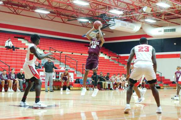 Clear Creek's Nate Jackson (12) puts up a shot against South Houston during the Carlisle-Krueger Classic basketball tournament Thursday, Nov 30 at Clear Lake High School.