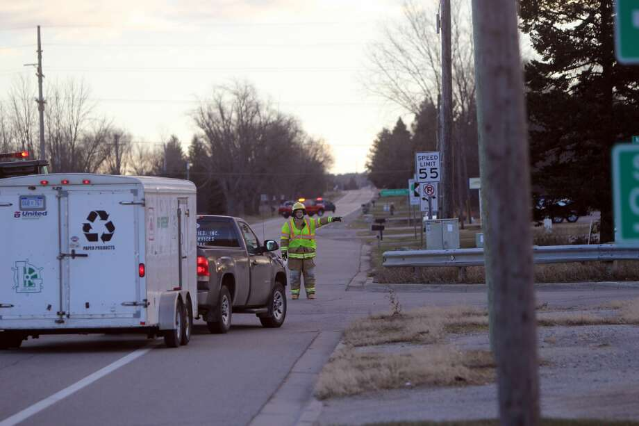 Bad Axe firefighters were called to the scene of a downed power line around 5:30 a.m. this morning east of the city on M-142, between Nugent and Hellems roads. High winds overnight caused several power outages throughout the county. Photo: Seth Stapleton/Huron Daily Tribune