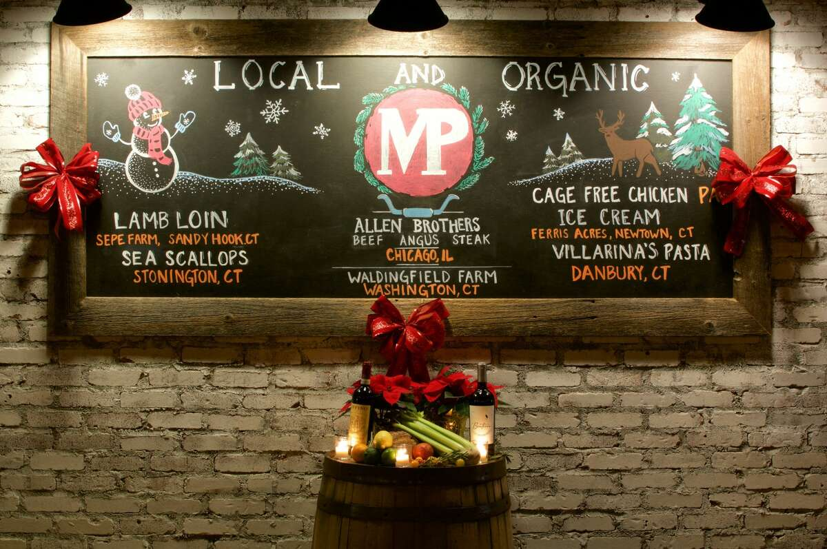 A chalkboard shows what's on the menu at Market Place Kitchen & Bar in Newtown.