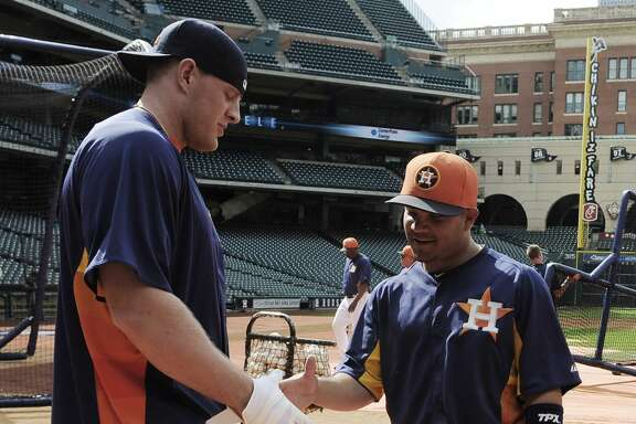Houston Texans football player J.J. Watt, left, greets Houston Astros' Jose Altuve at batting practice before an exhibition baseball game against the Chicago Cubs Friday, March 29, 2013, in Houston. (AP Photo/Pat Sullivan)