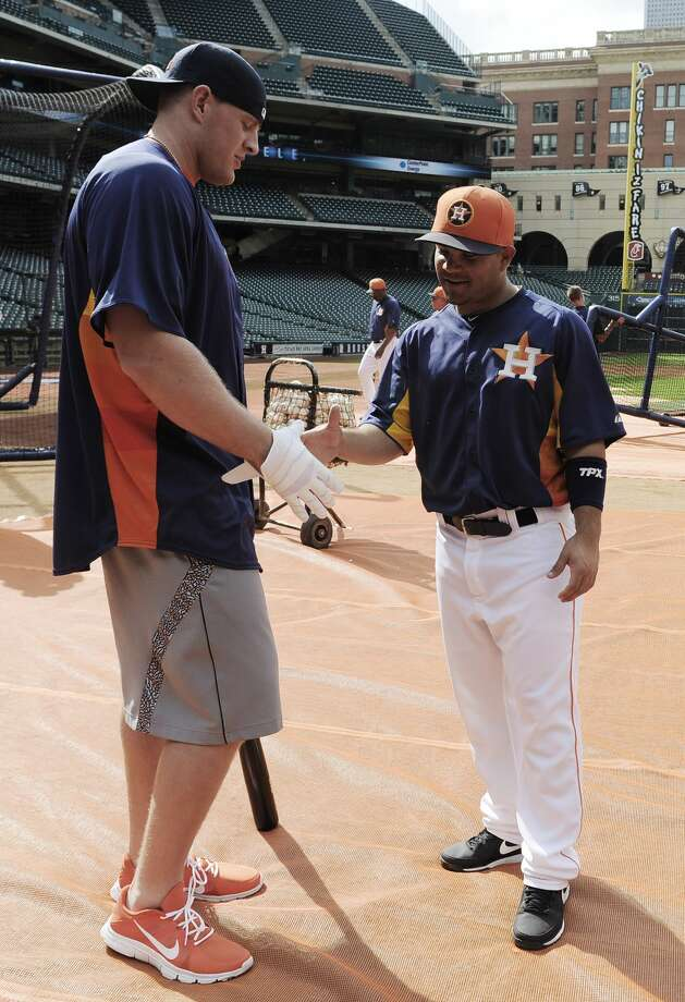 """Houston Texans football player J.J. Watt, left, greets Houston Astros' Jose Altuve at batting practice before an exhibition baseball game against the Chicago Cubs Friday, March 29, 2013, in Houston. (AP Photo/Pat Sullivan)Browse through the photos for a look at the Sports Illustrated covers for their Sportsperson of the Year issue each year andWatt's appearance onNBC's """"The Tonight Show Starring Jimmy Fallon"""" on Monday night. Photo: Pat Sullivan/AP"""