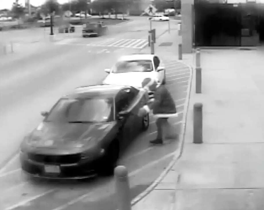 """Houston police staged a video of a """"Grinch"""" breaking into cars and stealing gifts to warn residents about holiday car thefts. Police released the video on Dec. 4, 2017. Photo: Houston Police Department"""