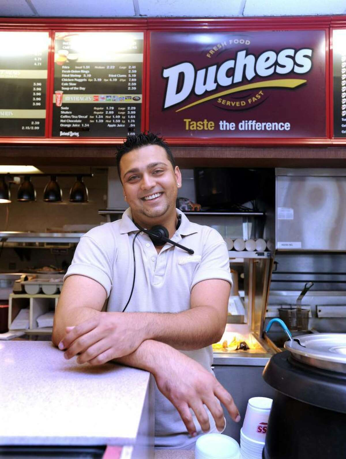 """Sunny Malhotra, 27, of Danbury. His parents, owners of two Dutchess Restaurants in Danbury, are from India and are naturalized American citizens. """" Sometimes you expect this to be the land of opportunity but it doesn't always turn out that way. I've done my bachelor's degree, Master's in business and I went overseas to earn a certification as a SAP consultant within the IT field but after all of it, I'm still back here helping my parents out at Dutchess. So sometimes it makes you wonder, what was it all for?"""""""