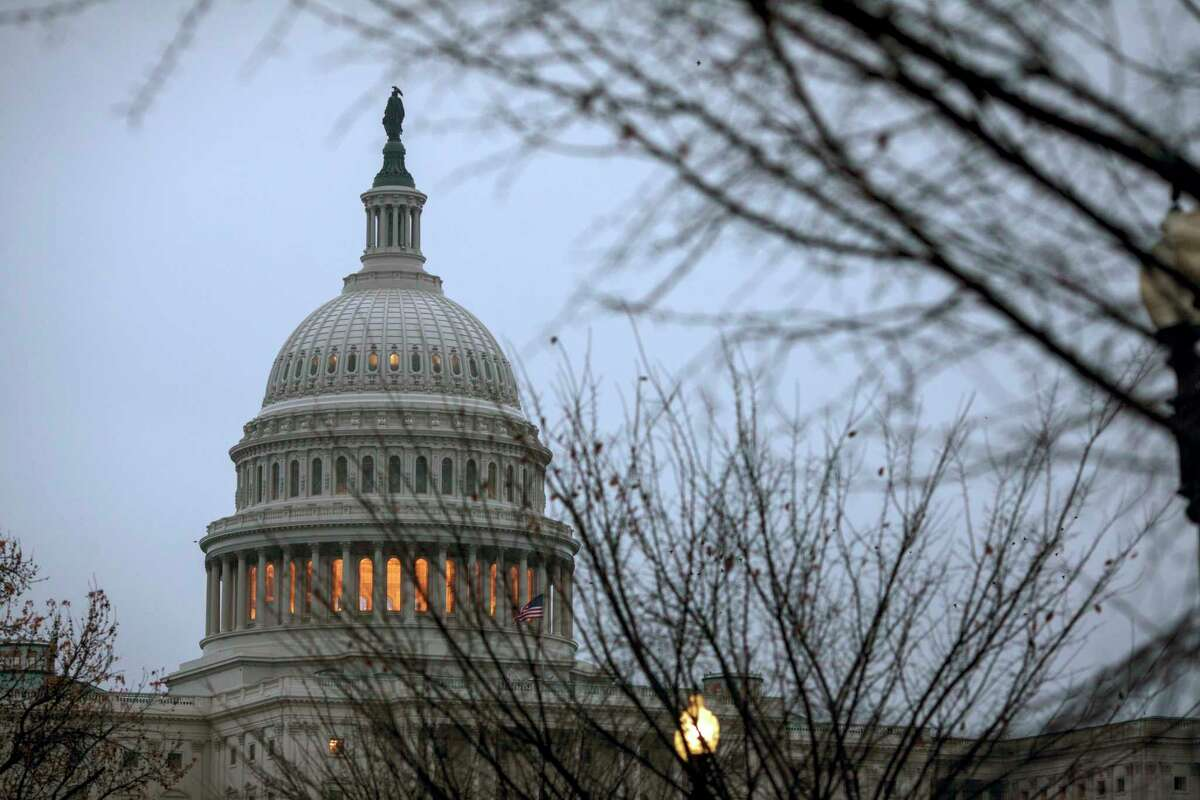 The Capitol is seen in Washington, early Tuesday, Dec. 5, 2017, days before a budget clash could produce a partial government shutdown by the weekend unless there's an agreement on a measure temporarily keeping agencies open.