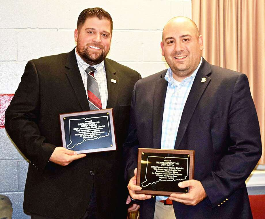 State Rep. Brian Ohler, R-North Canaan, left, recently received the Connecticut State Firefighters Association Legislator of the Year Award. He is pictured with state Rep. Pat Boyd, D-Brooklyn, who joins Ohler on a newly formed Fire/EMS Caucus. Photo: Contributed Photo /Not For Resale
