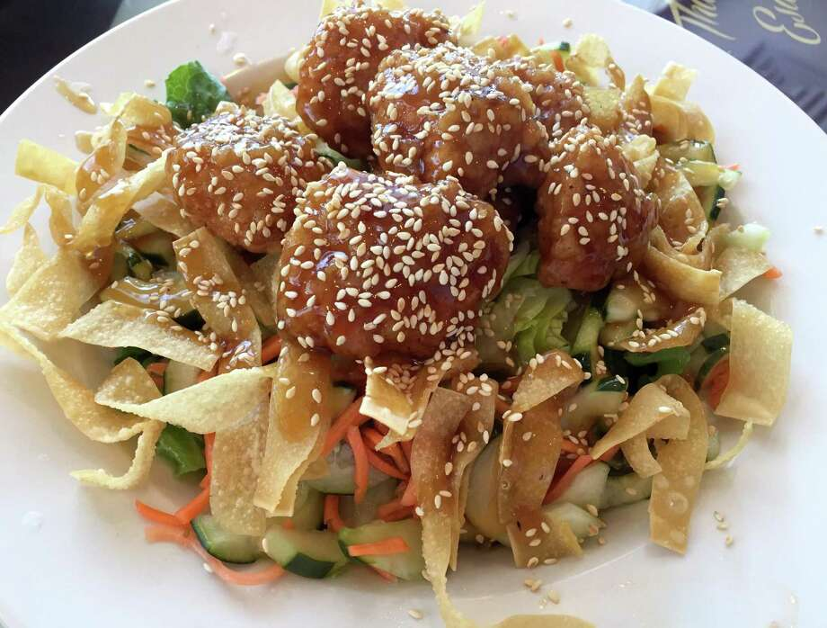 The Thai Asian Salad at Thai Esan & Noodle House features vegetables and crispy fried chicken and rice noodles. Photo: Paul Stephen / San Antonio Express-News