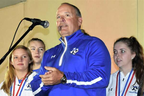 Needville ISD Superintendent Curtis Rhodes welcomed the high school's state champion volleyball team to the stage at Needville Country Christmas last Friday. From left are team members Rockie Thielemann, Madison Schultz, Rhodes and team member Rassy Case.