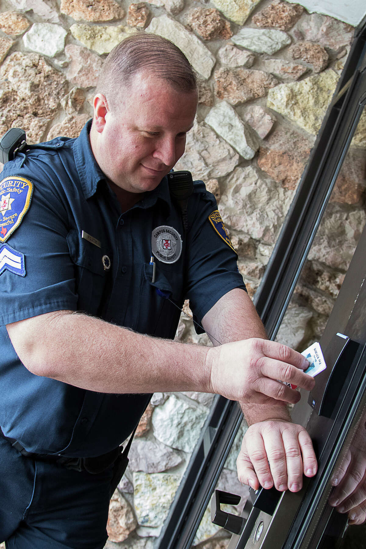 """Wharton County Junior College Public Safety Corporal Steven Fojtik uses a new """"prox"""" card to access Mullins Hall on the Wharton campus. The upgraded door locks are part of a comprehensive plan to improve the safety and security of WCJC's campuses."""