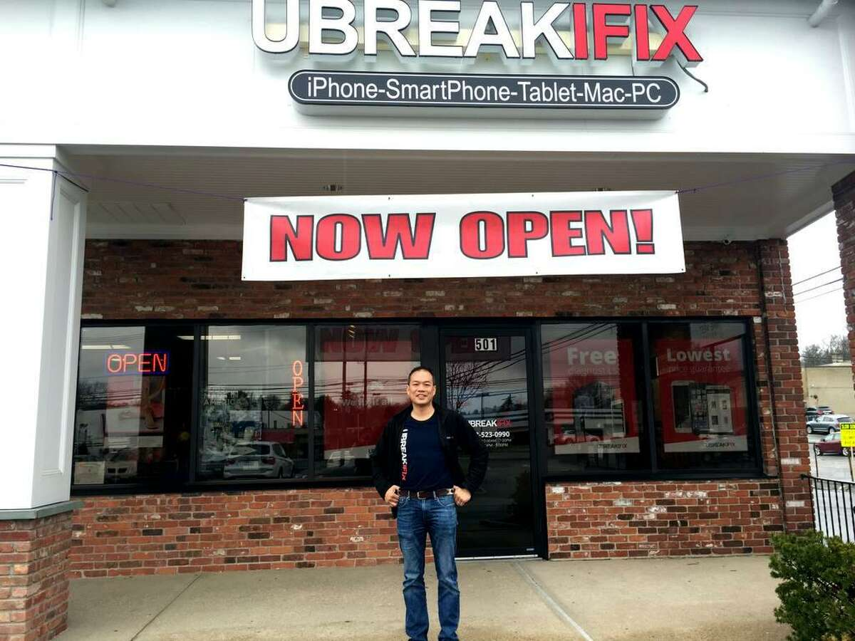 A file photo of Daniel Lew outside his uBreakiFix electronics repair shop in Norwalk, Conn. In late November 2017, Lew opened a third uBreakiFix at 1761 Post Road E. in Westport.