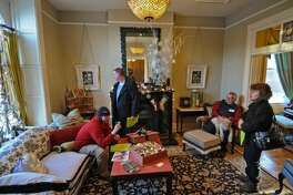 Homeowner Fred Masters, second from right, sits with his dog Calder in the living room of his home at 126 Central Avenue, built in 1888, during the Historic Albany Foundation's 9th annual Holiday House Tour 2011 on Sunday Dec. 11, 2011. (Times Union Archive)