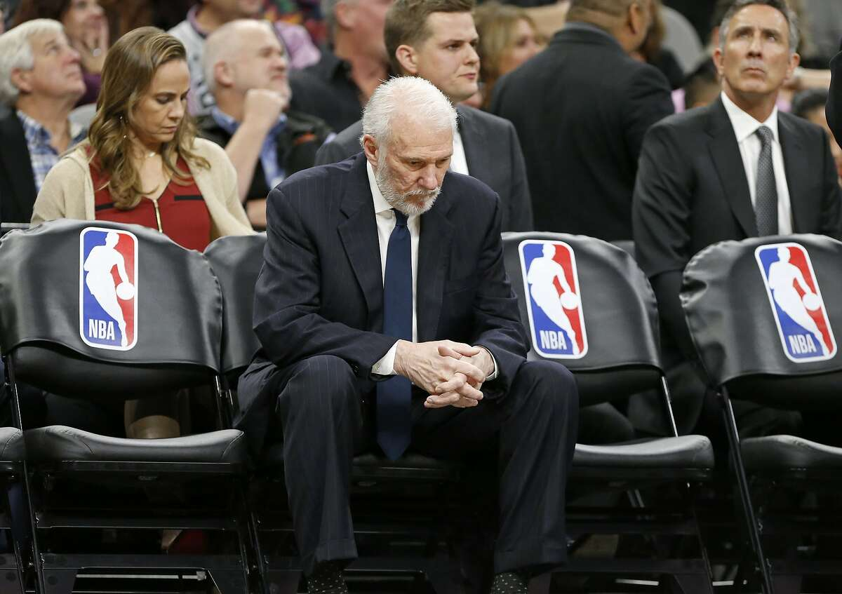 San Antonio Spurs head coach Gregg Popovich sits on the bench during a timeout in first half action against the Milwaukee Bucks Friday Nov. 10, 2017 at the AT&T Center.