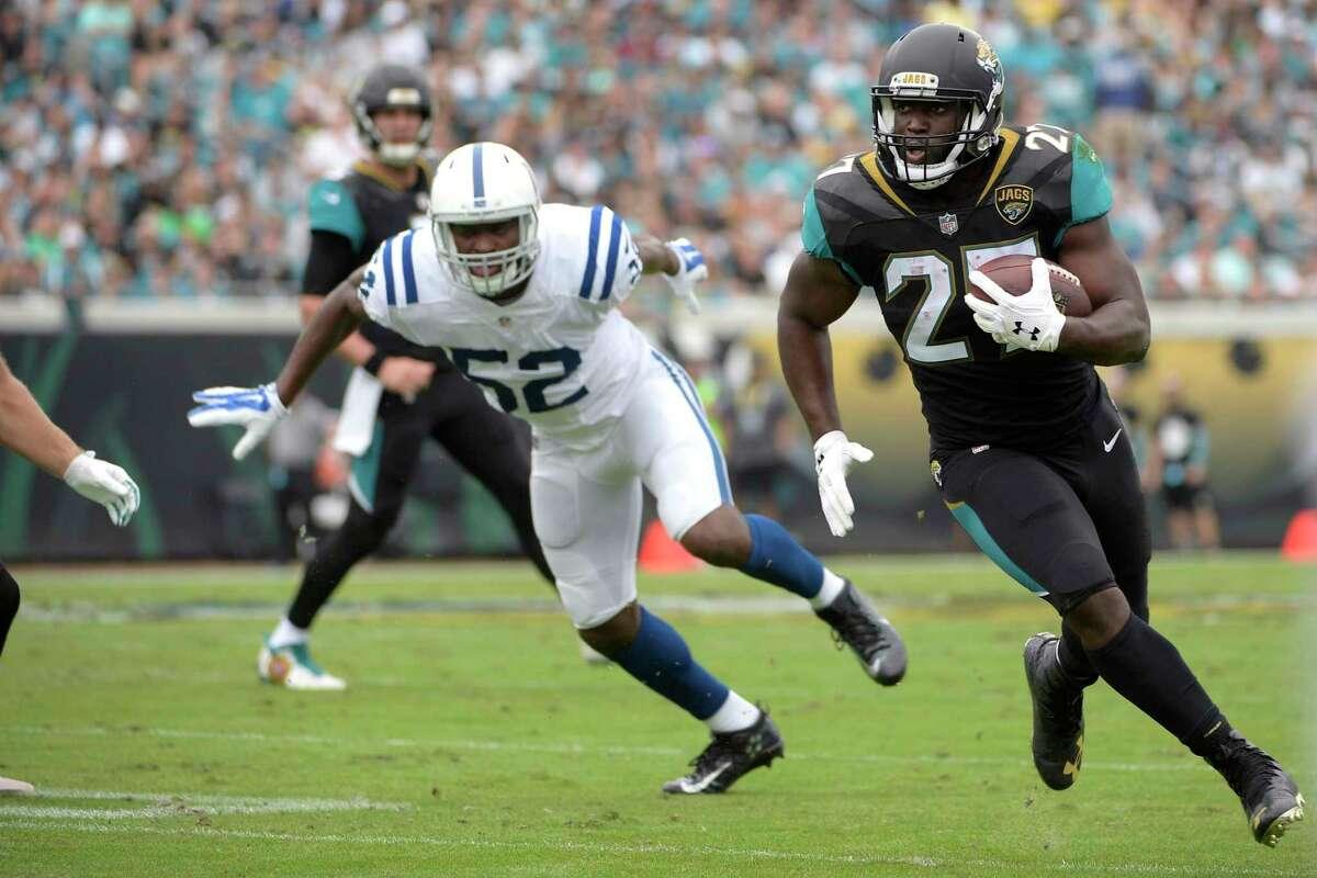 Jacksonville Jaguars running back Leonard Fournette (27) rushes for yardage past Indianapolis Colts outside linebacker Barkevious Mingo (52) during the first half of an NFL football game Sunday, Dec. 3, 2017, in Jacksonville, Fla. (AP Photo/Phelan M. Ebenhack)
