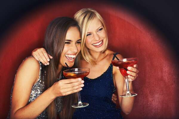 Two gorgeous young woman enjoying cocktails
