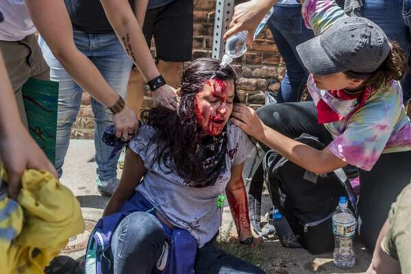 "CHARLOTTESVILLE, VIRGINIA, UNITED STATES - 2017/08/12: (EDITORS NOTE: Image contains graphic content)On Saturday, August 12, 2017, a veritable who's who of white supremacist groups clashed with hundreds of counter-protesters during the ""Unite The Right"" rally in Charlottesville, Va. Dozens were injured in skirmishes and many others after a white nationalist plowed his sports car into a throng of protesters.  One counter-protester died after being struck by the vehicle. The driver of the car was caught fleeing the scene and the Governor of Virginia issued a state of emergency. (Photo by Michael Nigro/Pacific Press/LightRocket via Getty Images)"