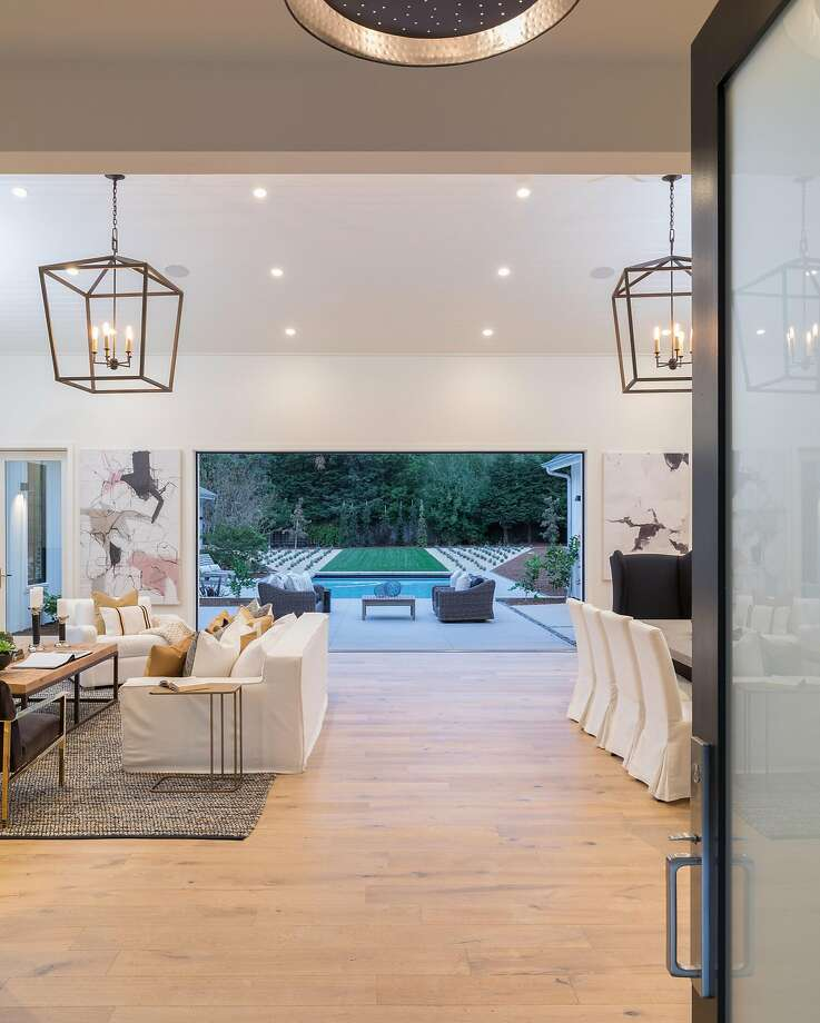 The front door opens to a spacious living room that steps out to the backyard