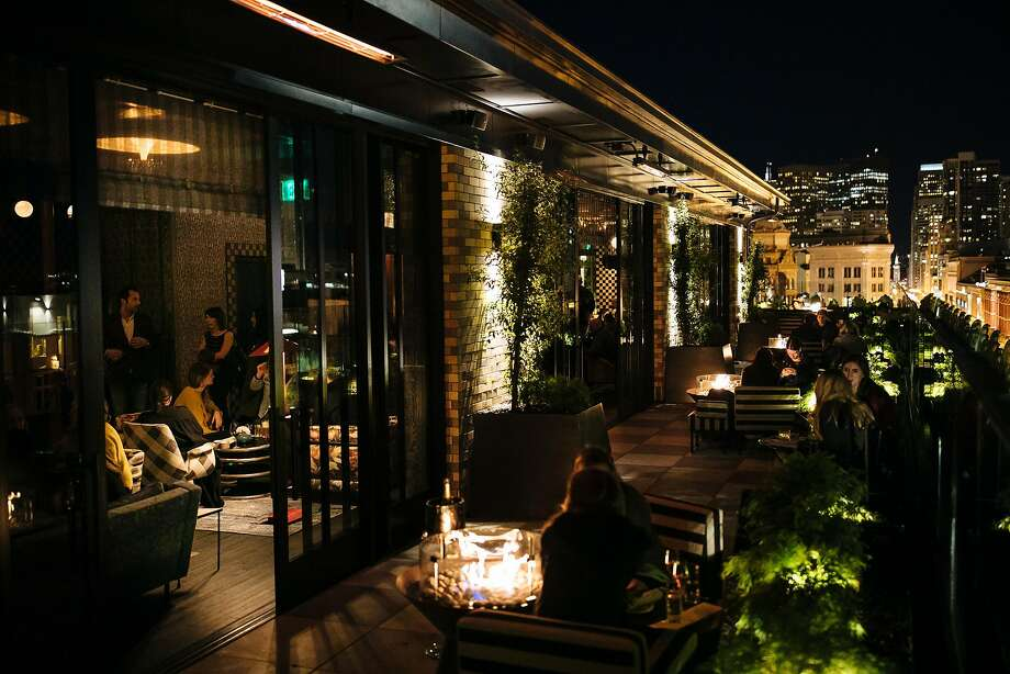 Charmaine's bar (left) leads to the outdoor patio atop the Proper Hotel in S.F. Photo: Mason Trinca, Special To The Chronicle