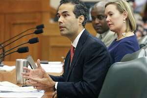 Land Commissioner George P. Bush, with Deputy Land Commissioner Anne Idsal, answers question Tuesday as the Senate Finance Committee takes up expenditures on the Alamo by the General Land Office.