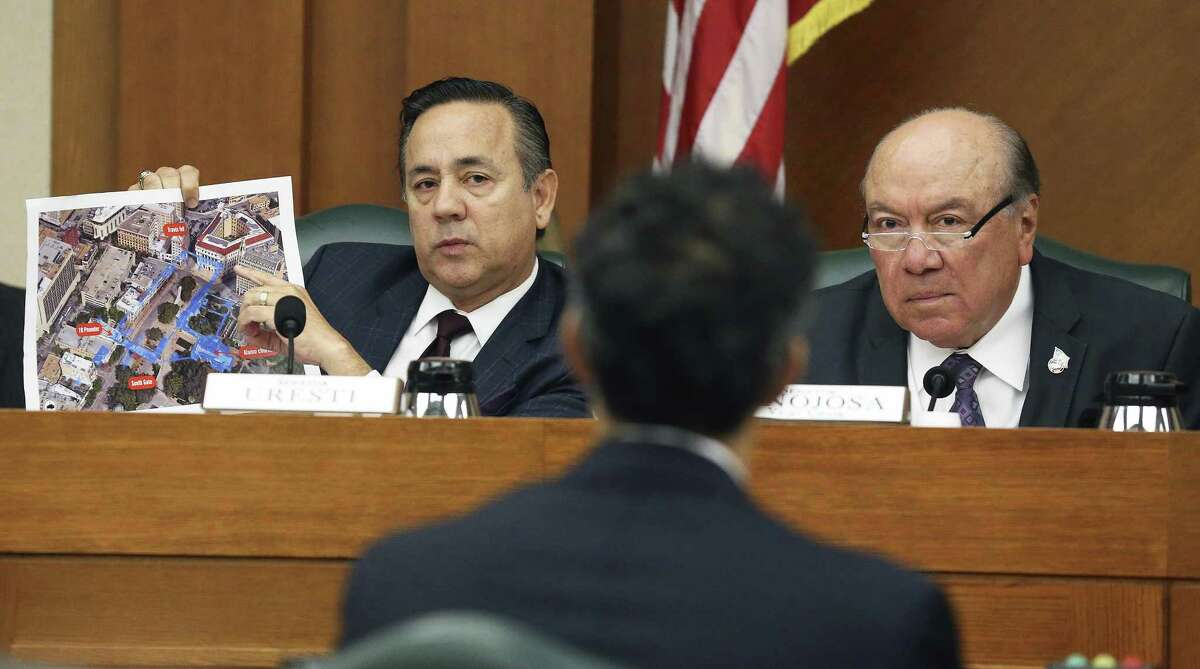 Sen. Carlos Uresti, D-San Antonio, quizzes Land Commissioner George P. Bush about grounds proposals as Sen. Juan Hinojosa, D-MacAllen, listens in during the Tuesday hearing held by the Senate Finance Committee.