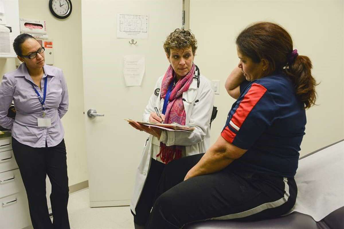 Health Coach Juanita Castillo, (left) a certified diabetes educator, participates in a medical visit for a patient of the Boehringer Ingelheim Americares Free Clinic in Danbury, Conn. Photo by Alex Ostasiewicz/Americares.