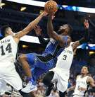 The Orlando Magic's Jonathon Simmons (17) shoots past the San Antonio Spurs' Danny Green (14) and Brandon Paul (3) during the first half at the Amway Center in Orlando, Fla., on Friday, Oct. 27, 2017. (Stephen M. Dowell/Orlando Sentinel/TNS)