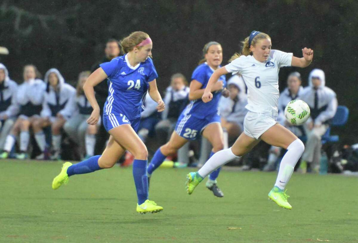 Wilton's Lindsay Groves (6) heads the ball down the field.